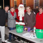 Santa's helpers in charge of organizing Caroling on The Circle.