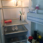 Though the light in Maldonado's refrigerator still works, power outages during Hurricane Maria broke the mechanism that chills the food — and the insulin he depends on. (Sarah Varney/KHN)