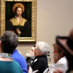 A group of older adults and their caregivers analyze and discuss works of art on March 5 as part of the National Gallery's Just Us program. (Lynne Shallcross/KHN)