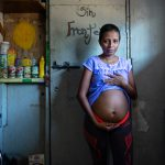 """Grevy Marisela Jimenez Martinez, 28, a migrant from Honduras, has been living in the shelter for the past four months. She is almost five months pregnant and is expecting twins. """"I hope they are born in the United States. I want a better future for them,"""" she says."""