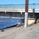 In the city of Vernon, a homeless encampment is hidden under a bridge that crosses the Los Angeles River. (Anna Almendrala/Kaiser Health News)